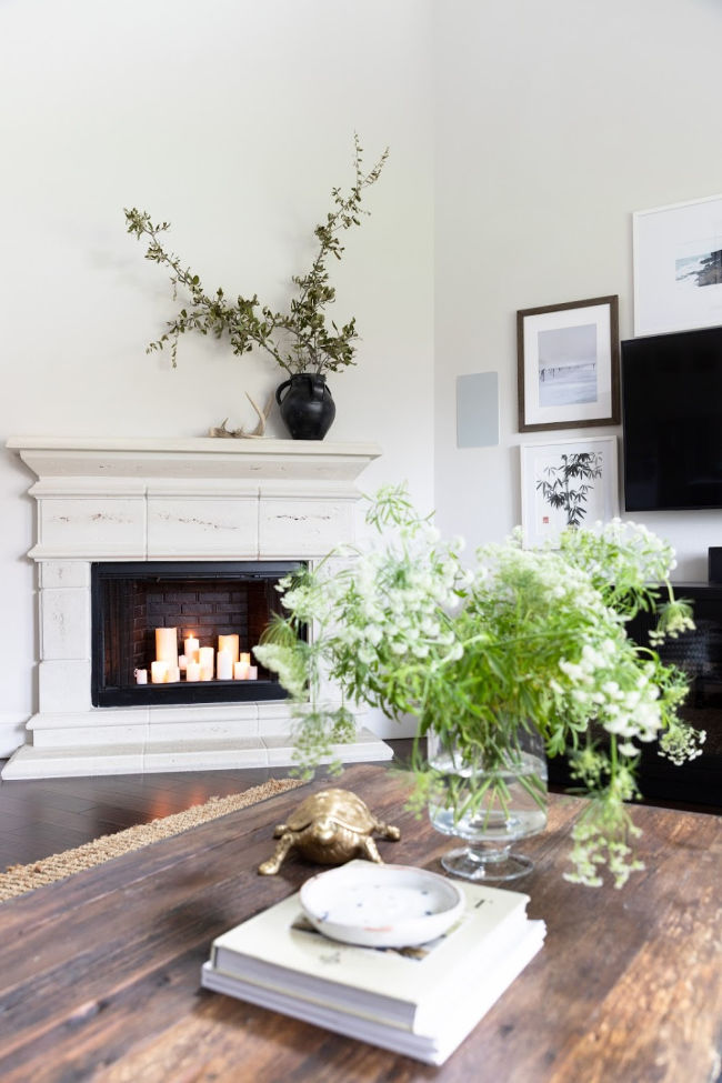 12 Creative Fall Mantels - love the simplicity of a single vase holding branches kellyelko.com #fall #falldecor #mantel #manteldecor #neutraldecor #farmhousedecor