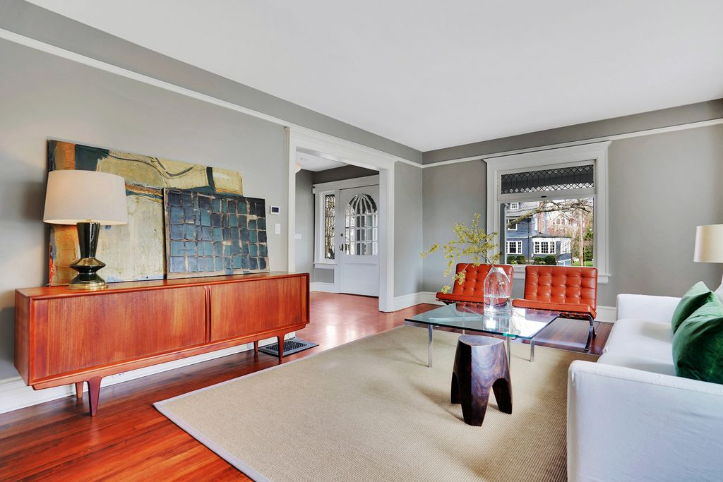 Love this old home with mid century modern furniture kellyelko.com #midcenturymodern #midcentury #danishmodern #livingroomdecor #vintagemodern #eclecticdecor #graypaint