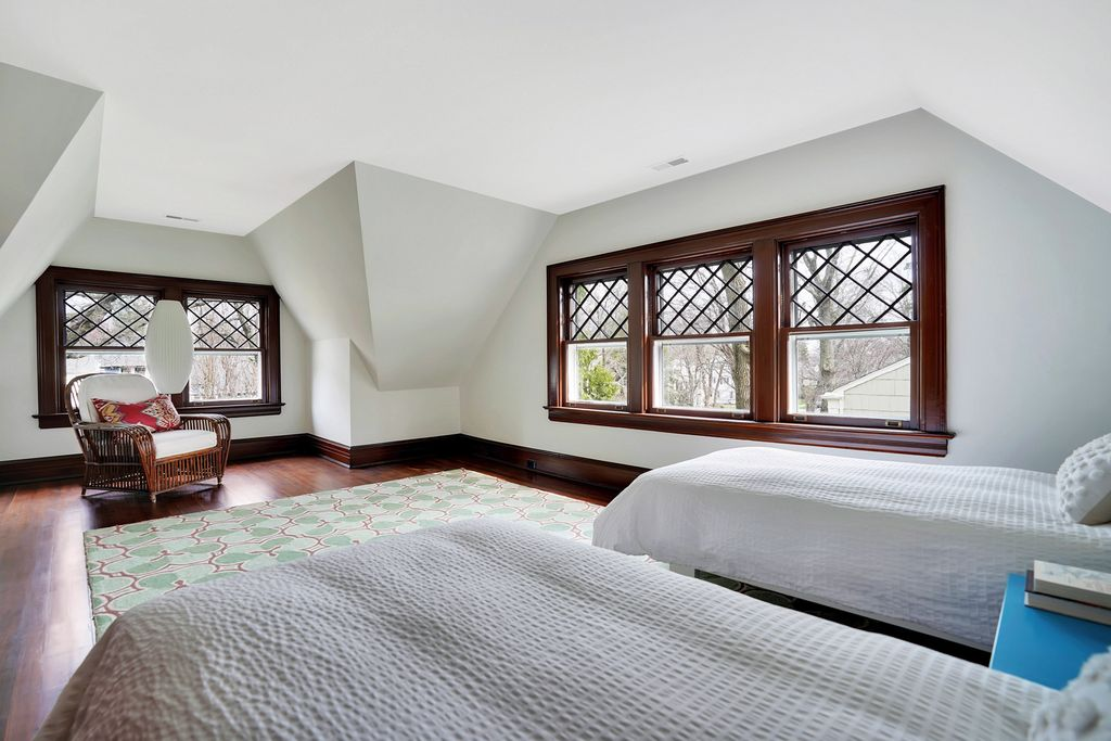 Old home with original diamond paned windows in this huge attic bedroom kellyelko.com #oldhome #oldhouse #architecture #housetour #hometour #bedroomdecor #bedroomdesign