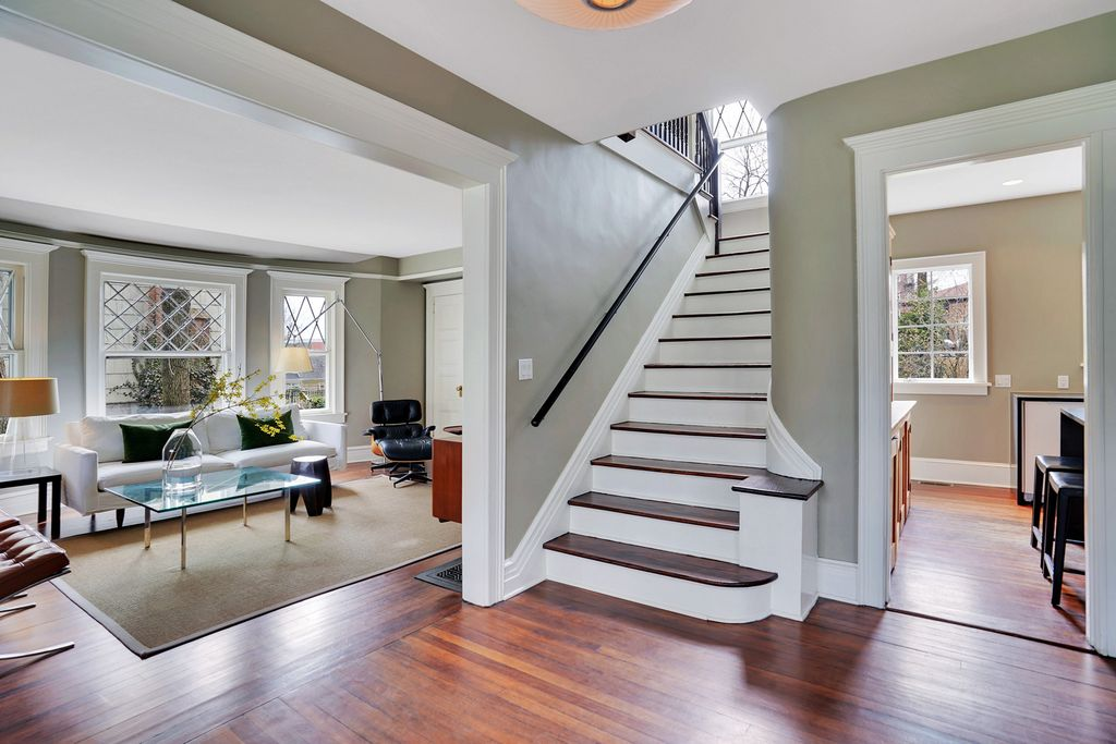 Tour this 1900 home updated with modern touches kellyelko.com #foyer #oldhome #vintagemodern #hometour #housetour #staircase #woodfloors #graypaint #eclecticdecor
