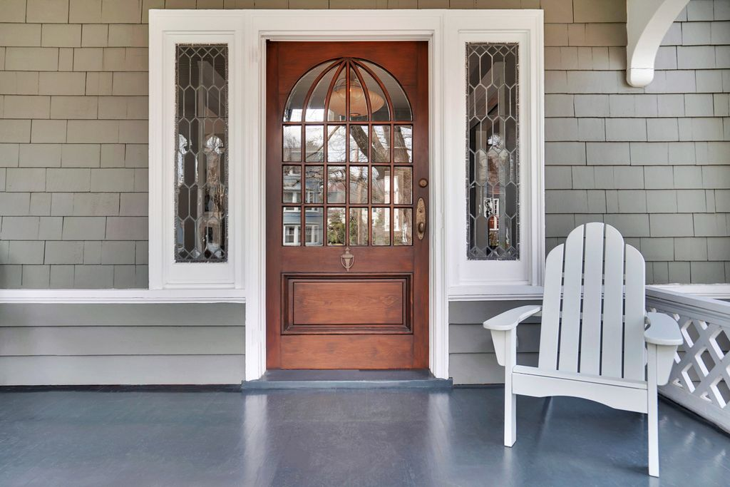 Eclectic Home Tour Carpenter Gothic - love the original front door and leaded glass sidelights in this 1900 home kellyelko.com #home #frontdoor #oldhome #oldhouse #hometour #housetour #architecture #victorian #olddoor #porch #frontporch
