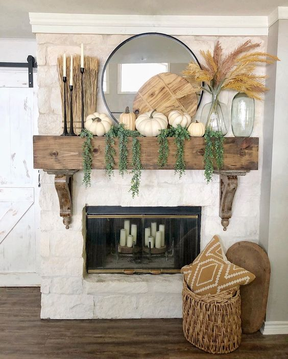 12 Creative Fall Mantels - love this neutral rustic fall mantel natural elements kellyelko.com #fall #falldecor #falldecorating #fallmantel #farmhousedecor #farmhousestyle #mantels #eclecticstyle #neutraldecor #pumpkindecor