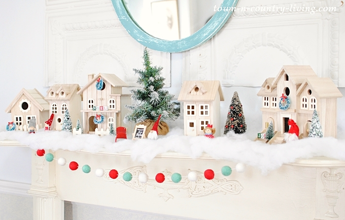 These adorable bird houses get a Christmas makeover kellyelko.com #christmasdecor #diychristmas #christmasdiy #christmasmantel #christmasdecorating #birdhouse #christmascrafts #kidschristmas #kellyelko