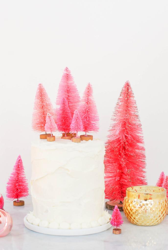 Bottle Brush Tree Ideas - love this cake topped with a forest of pink bottle brush trees #cake #bake #recipes #christmasdessert #dessert #bottlebrushtrees #christmasparty