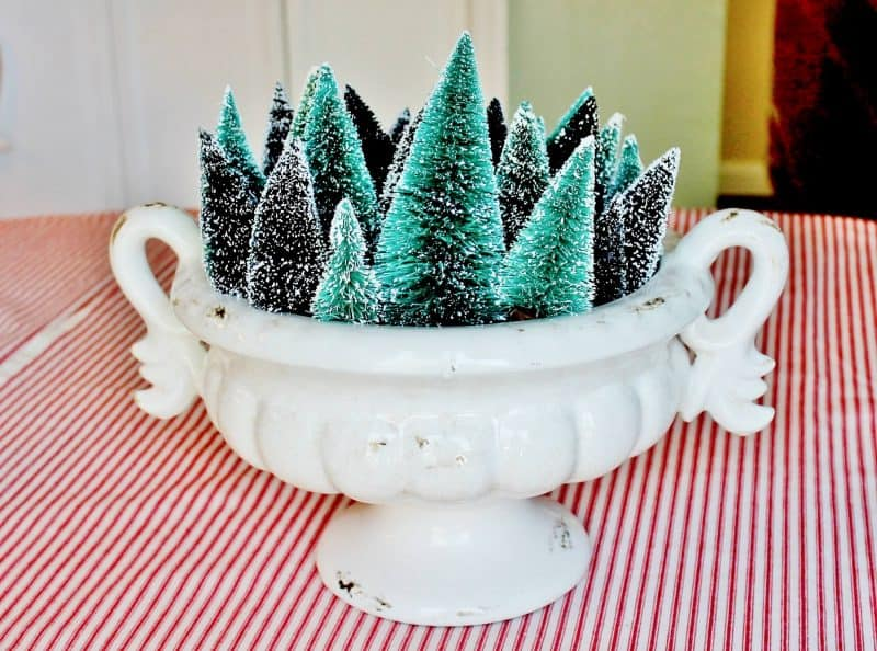 Creative Bottle Brush Tree Ideas - love this urn filled with a forest of little trees #vintagechristmas #christmasdecor #christmastrees #bottlebrushtrees