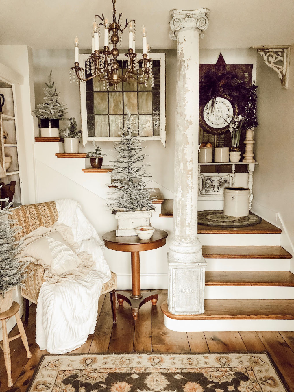 Farmhouse entry decorated for Christmas with mini trees in vintage crocks #christmastree #vintagechristmas #farmhousechristmas #farmhouse #entry #vintagedecor #neutraldecor