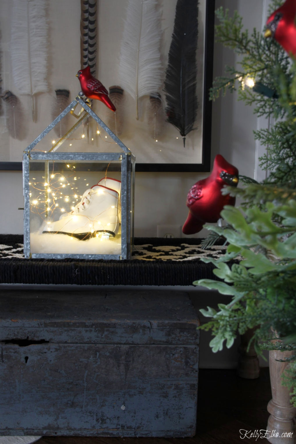 Creative Christmas Home Tour - love the lantern filled with ice skates and fairy lights kellyelko.com #christmas #christmasdecor #christmasdecorating #christmashome #christmastour #diychristmas #christmasideas #christmasmantel #christmastree #christmasornaments #vintagechristmas #farmhousechristmas #colorfulchristmas #creativechristmas #kellyelko #fairylights #cardinals
