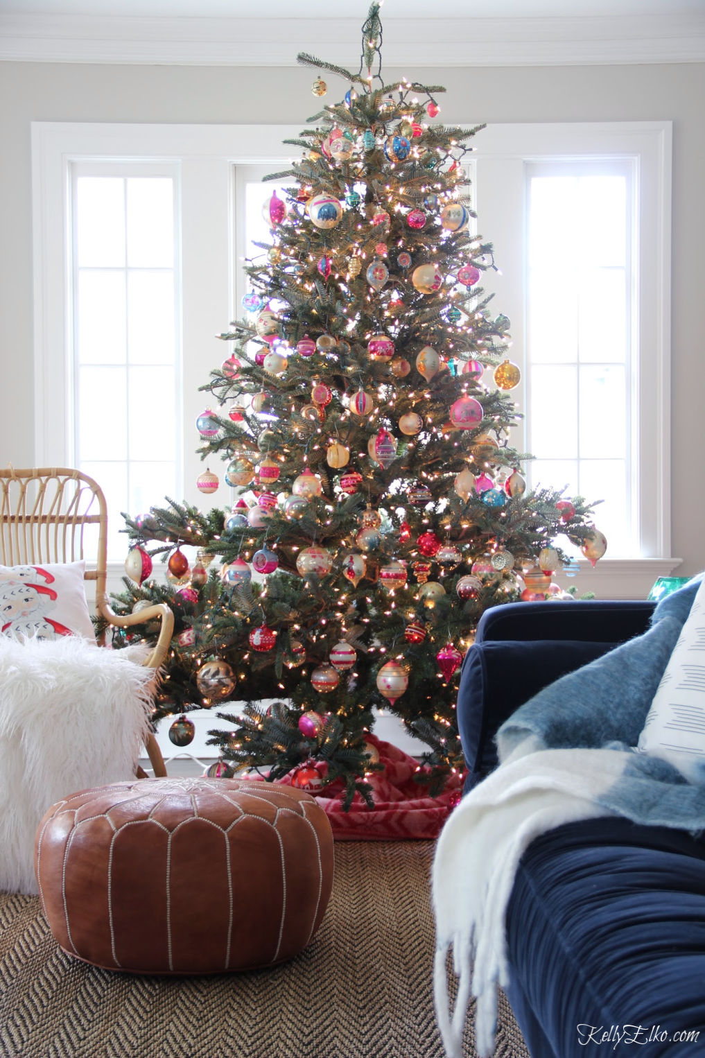 Wow! This Christmas tree is covered in vintage Shiny Brite ornaments kellyelko.com #christmas #vintagechristmas #christmastree #realistictree #realisticchristmastree #vintageornaments #christmasornaments #shinybrite #farmhousechristmas #christmasdecorations #retrochristmas #colorfulchristmas #christmastree