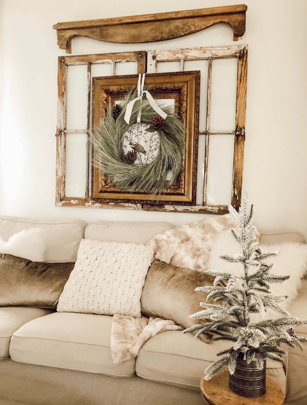 Old windows are the perfect backdrop to art or a wreath #farmhouse #farmhousedecor #farmhousestyle #neutraldecor #cottagestyle #christmaswreath #farmhousechristmas