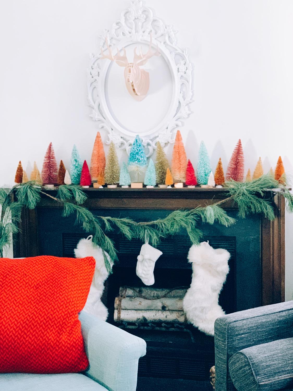 Colorful bottle brush tree Christmas mantel #christmasdecor #christmasmantel #bottlebrushtrees #christmastrees #