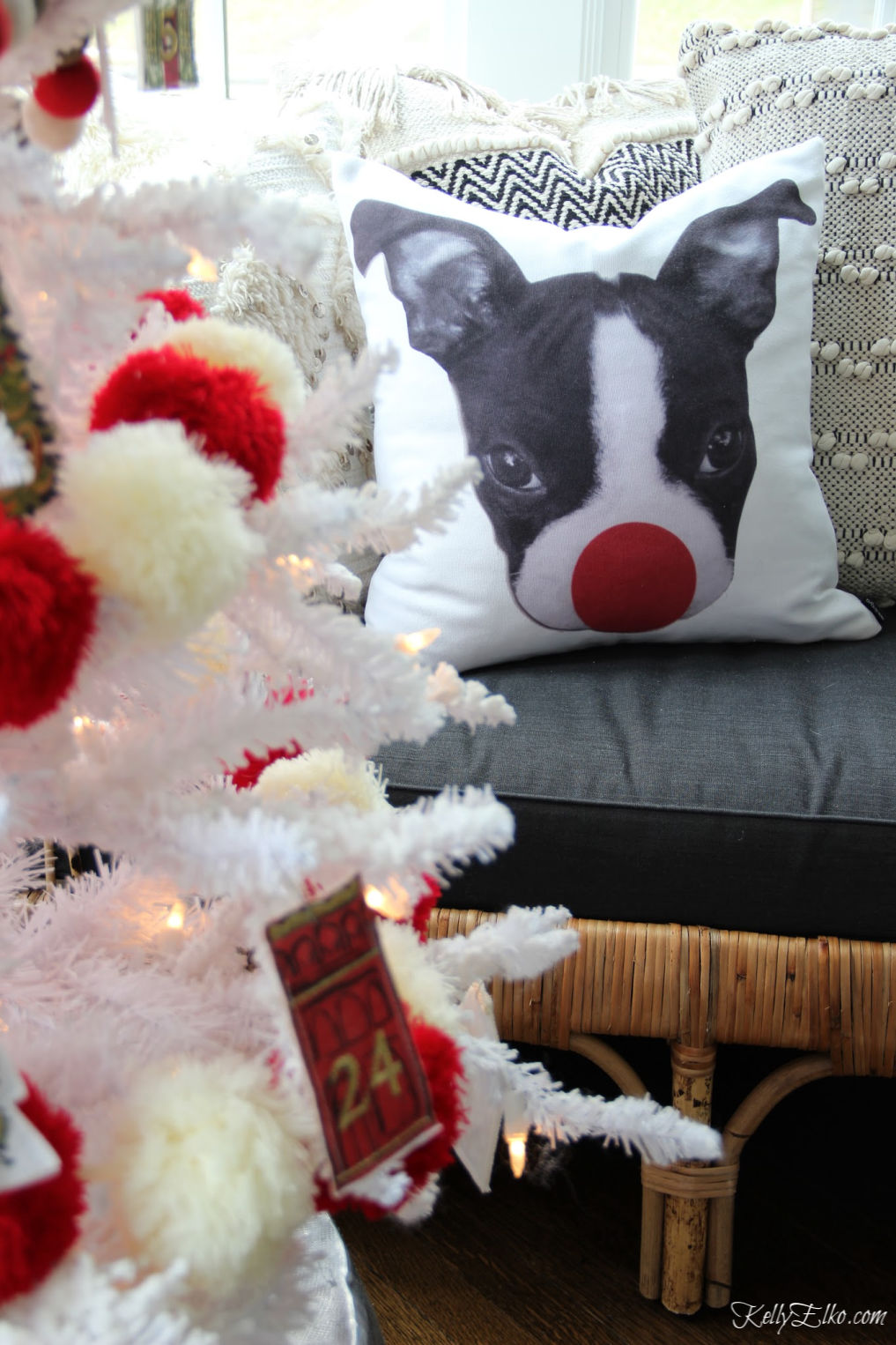 How adorable is this Christmas pillow of a Boston Terrier with a big red Rudolph nose! kellyelko.com #christmasdecor #christmaspillow #christmasdecorations #pillows #bostonterrier #bostonterrierdecor #society6pillow #kellyelko