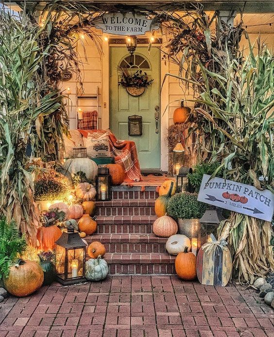 Tour this 200 year old farmhouse with fall front porch brimming with pumpkins kellyelko.com #farmhouse #frontporch #fallporch #pumpkins farmhousefall #farmhousedecor