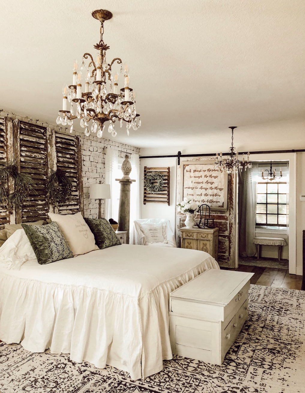 Farmhouse bedroom with brick wallpaper and a shutter headboard #farmhouse #farmhousedecor #farmhousebedroom #vintagedecor #vintagestyle #diyideas #diybed #bed #headboard
