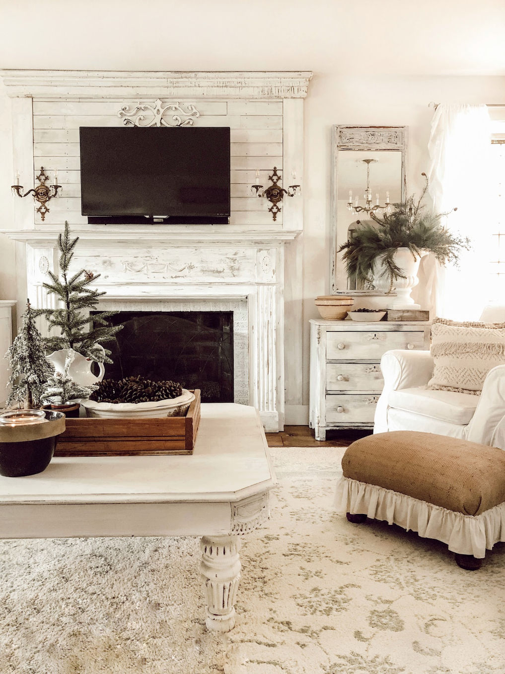 Love the shiplap fireplace wall in this neutral farmhouse family room #farmhousedecor #shiplap #fireplace #manteldecor #farmhousestyle #neutraldecor #christmasdecor #farmhousechristmas