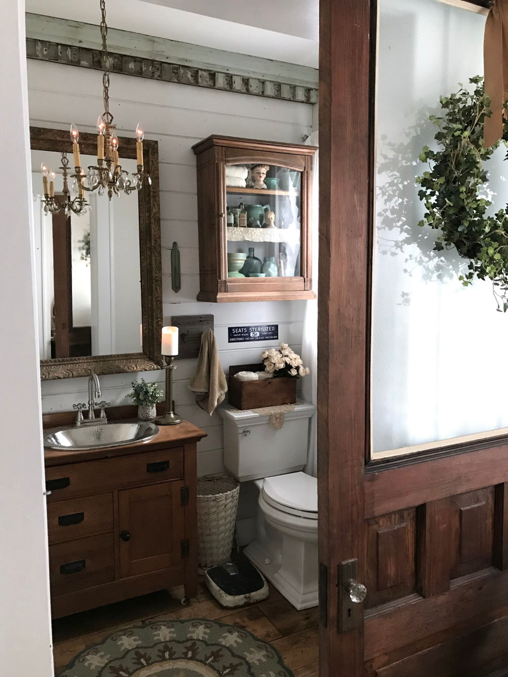 Farmhouse bathroom with old cabinet turned vanity #bathroom #powderroom #shiplap #farmhousebathroom #farmhousedecor #vintagedecor