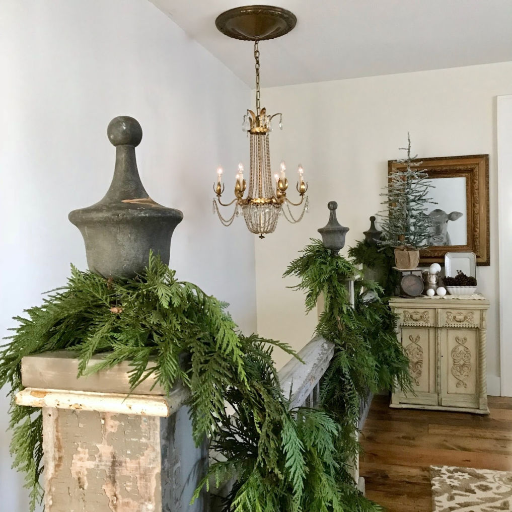 Fresh cedar garland on an antique bannister #christmas #christmasbannister #christmasgarland #vintagechristmas #farmhousechristmas