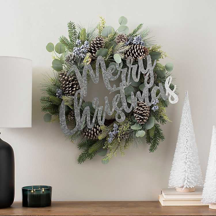 Add a galvanized metal sign to a plain wreath to turn it into a farmhouse Christmas wreath kellyelko.com #christmas #christmasdecor #diychristmas #christmaswreath #vintagechristmas