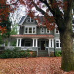 Beautiful old house with colorful fall leaves kellyelko.com #fall #fallfoliage #fallhouse #oaktree #oldhouse