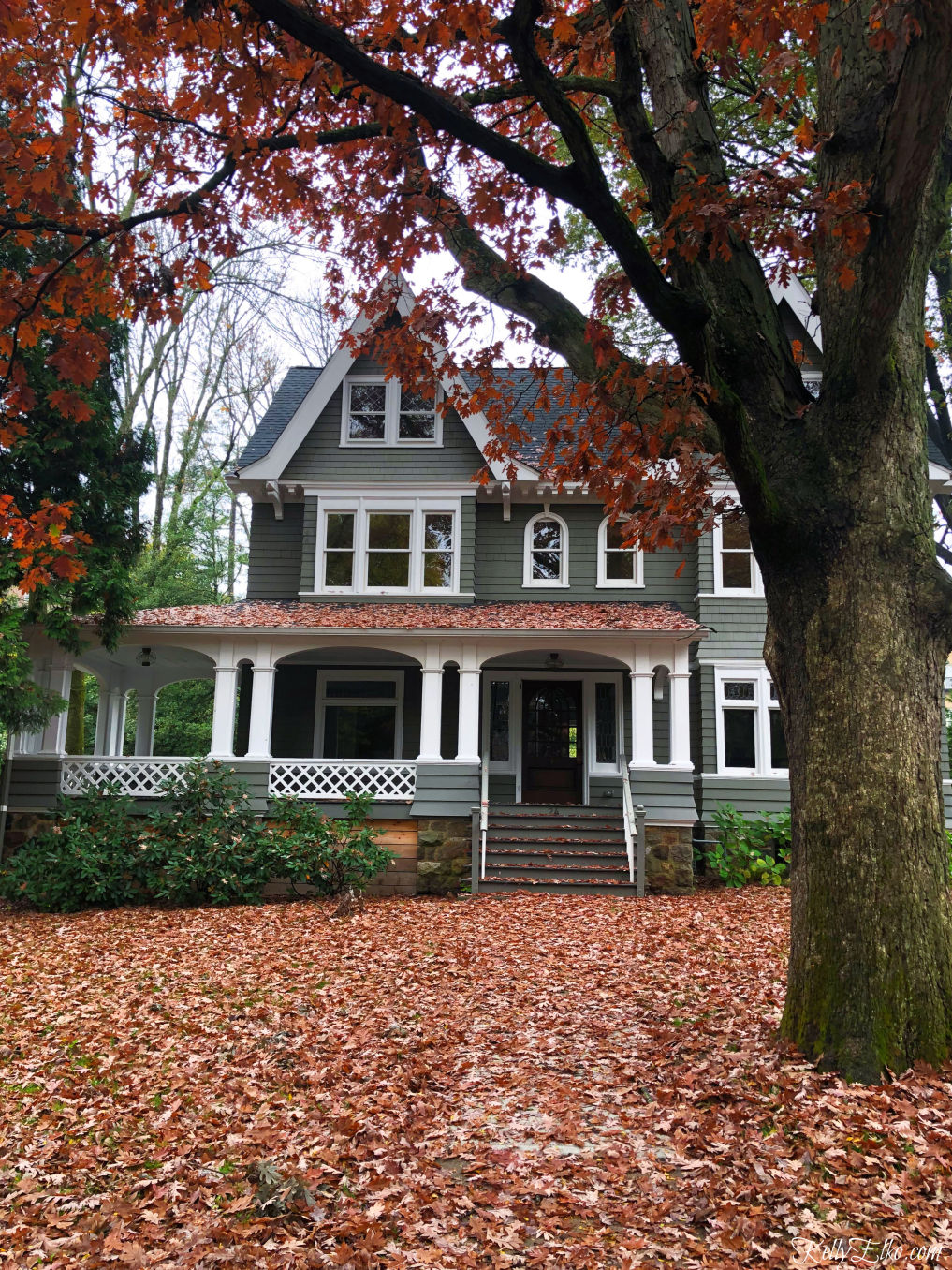 Kelly's Stamp of Approval - love this beautiful old house covered in colorful fall leaves kellyelko.com #fall #fallhome #fallfoliage #oldhouse #oldhome #fallporch #kellyelko