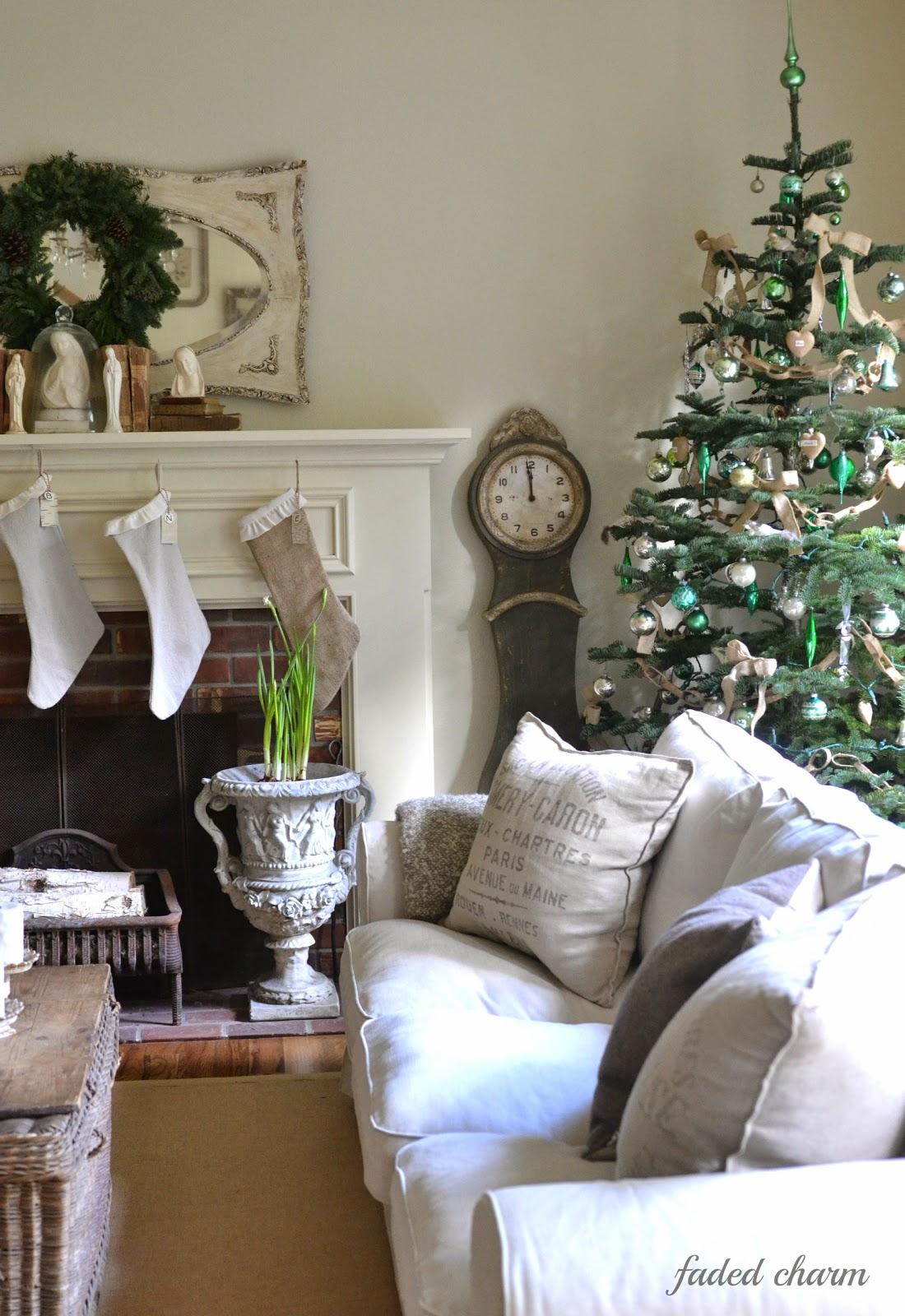 15 Sparse Christmas Trees - love this beautiful tree with green and silver vintage ornaments kellyelko.com #christmas #christmastree #sparsechristmastree #vintagechristmas #christmasdecor #christmasedecorating #christmasdecoratingideas #farmhousechristmas #christmasornaments #neutralchristmas #silvertip #kellyelko