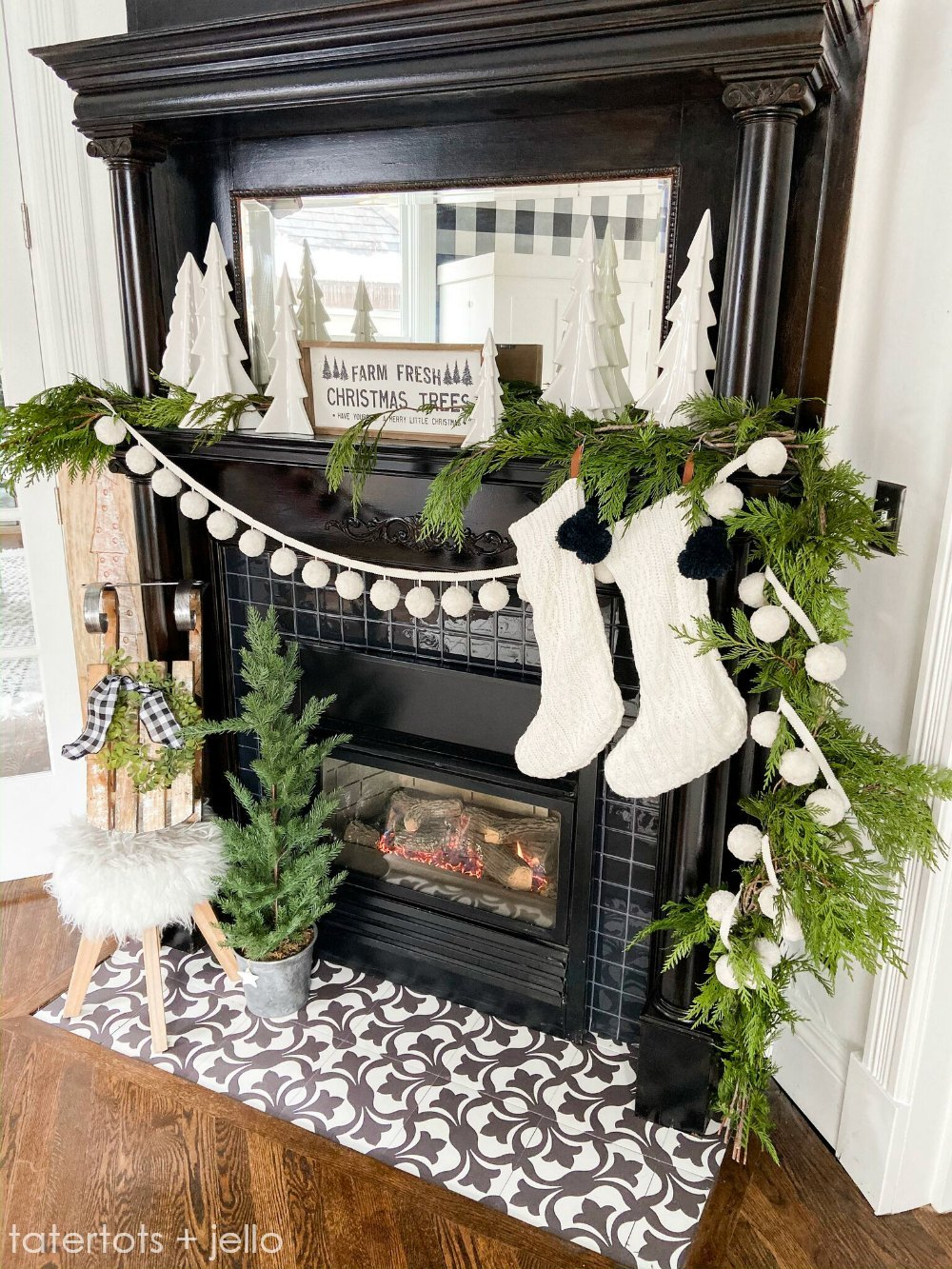 Festive Christmas Decorating Ideas - love this antique fireplace mantel with fresh garland and pom poms #christmas #christmasmantel #christmasdecor #vintagechristmas #christmastrees #fireplace #antiquemantel