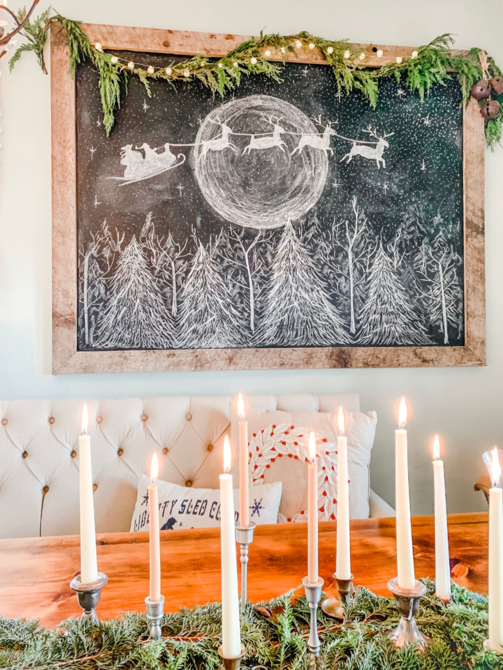 Stunning Christmas chalkboard with Santa and his reindeer flying across the moon. Inspired by the original art at kellyelko.com #chalkart #chalkboard #christmaschalkboard #christmaschalkart #santa #farmhousedecor #farmhousechristmas #christmasdecor #farmhousestyle #fixerupperstyle #kellyelko