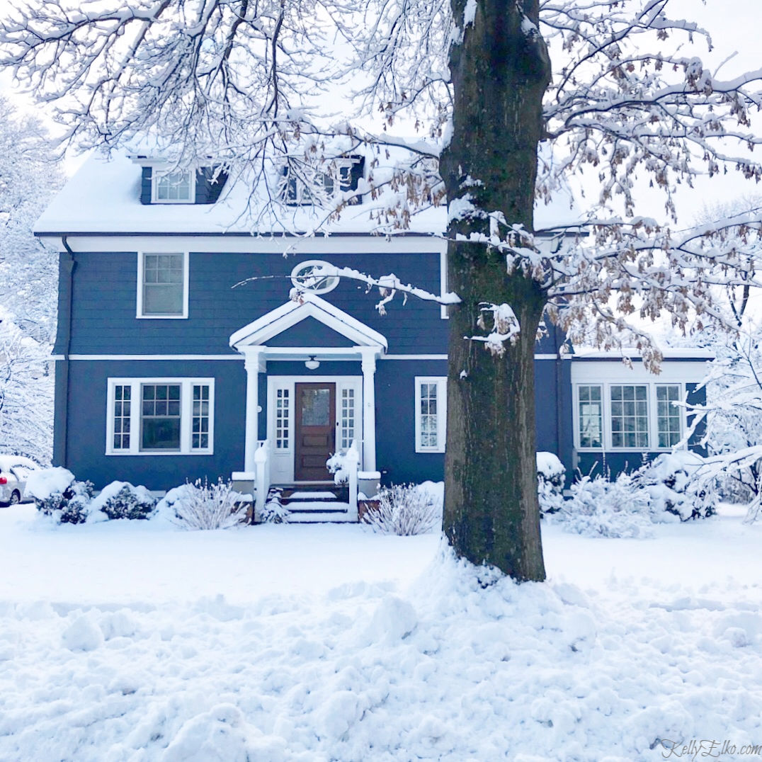 This blue house color really pops against the freshly fallen snow kellyelko.com #bluehouse #bluepaint #oldhouse #oldhome #curbappeal #snow #farmhouse #winterwonderland
