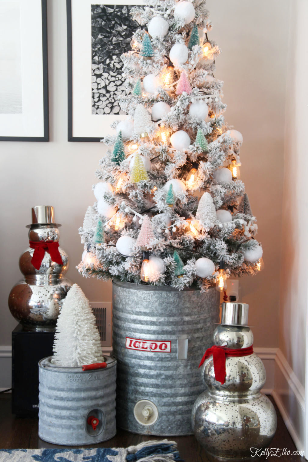 Love this flocked Christmas tree filled with little bottle brush trees kellyelko.com #vintagechristmas #christmastree #christmasdecor #thrifted #bottlebrushtree #mercuryglass #farmhousechristmas #kellyelko