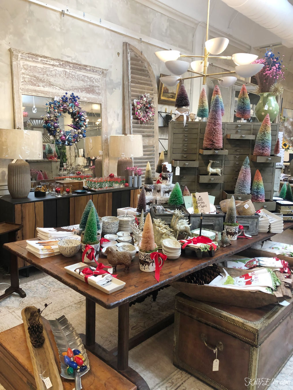 Get creative Christmas decorating ideas from local shops - love the bottle brush trees and vintage ornament wreaths kellyelko.com #christmasdecor #christmasdecoratingideas #vintagechristmas #christmastrees