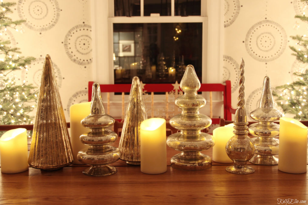 Christmas centerpiece of mercury glass trees and candles kellyelko.com #christmasdecor #christmascenterpiece #wintercenterpiece #christmastable #wintertable #mercuryglass #farmhousestyle #farmhousechristmas #fixerupperstyle #kellyelko
