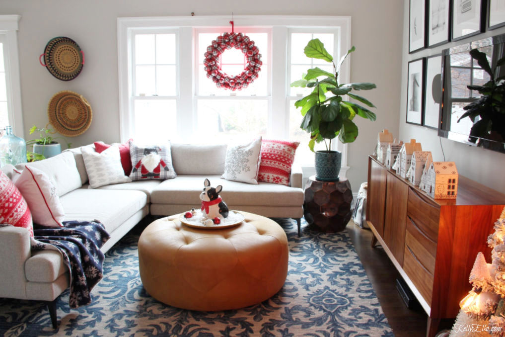 Colorful Christmas Home Tour - love the little Christmas houses, plaid wreath and gnome pillow kellyelko.com #christmas #christmasdecor #christmasdecorating #christmashome #christmastour #diychristmas #christmasideas #christmasmantel #christmastree #christmasornaments #vintagechristmas #farmhousechristmas #colorfulchristmas #creativechristmas #kellyelko #gnome #plaid #christmashouses #christmasfamilyroom