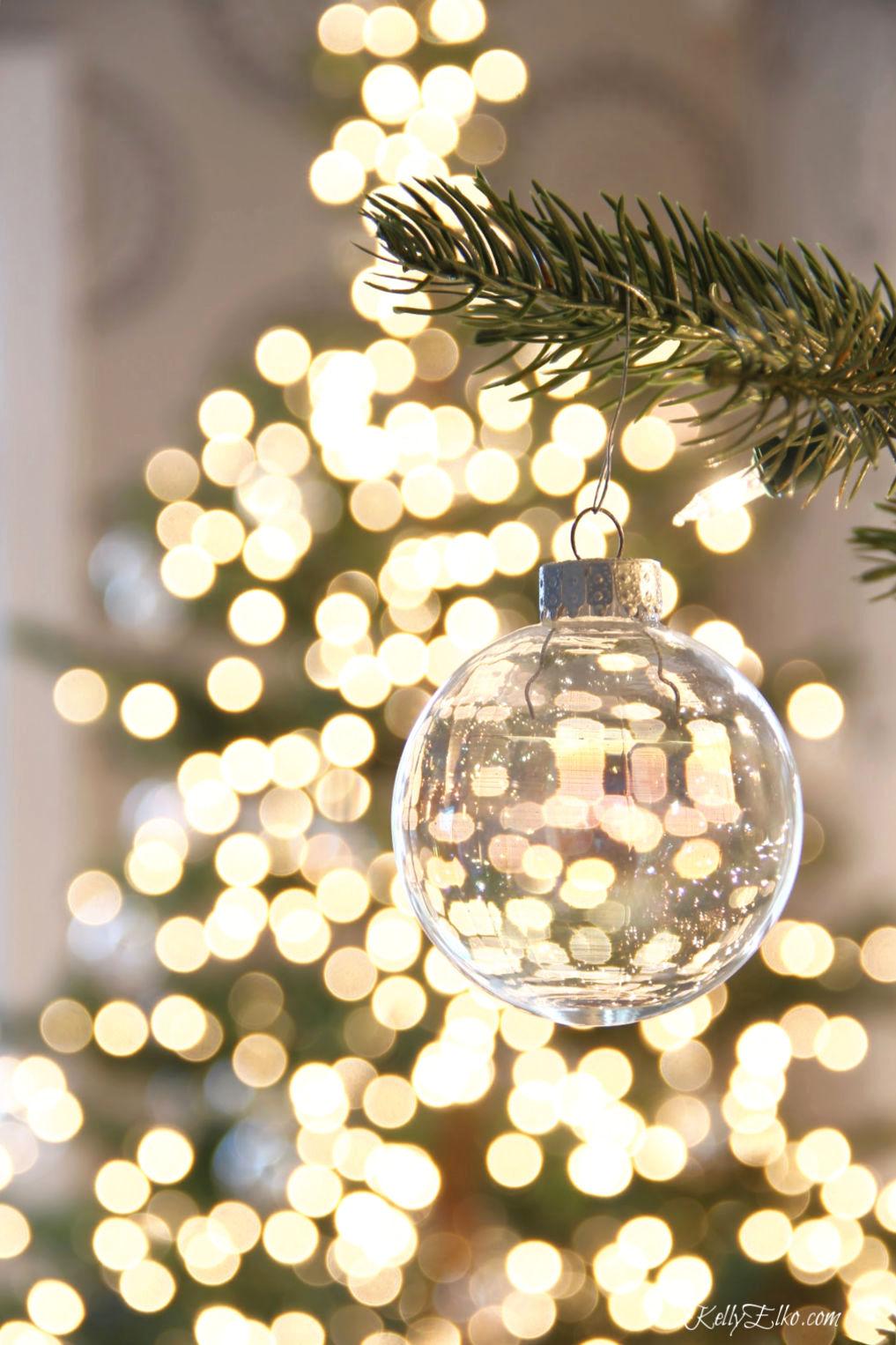 Clear Christmas Ornament bokah kellyelko.com #christmas #christmasdecor #christmasdecorating #christmashome #christmastour #diychristmas #christmasideas #christmasmantel #christmastree #christmasornaments #vintagechristmas #farmhousechristmas #colorfulchristmas #creativechristmas #kellyelko #bokah #clearornament #christmaslights