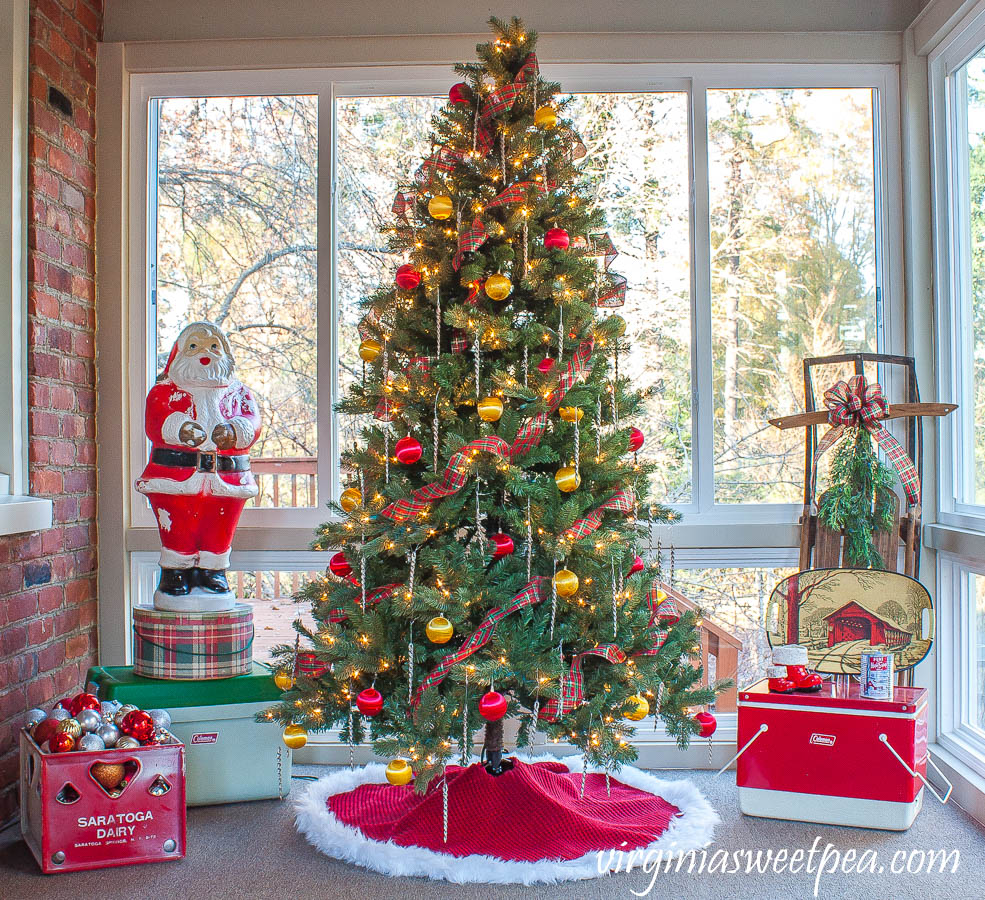 Love this fun and colorful vintage porch and the Santa blow mold, old coolers and sled #vintagechristmas #christmasdecor #kitschchristmas #blowmold #christmasporch #vintagedecor