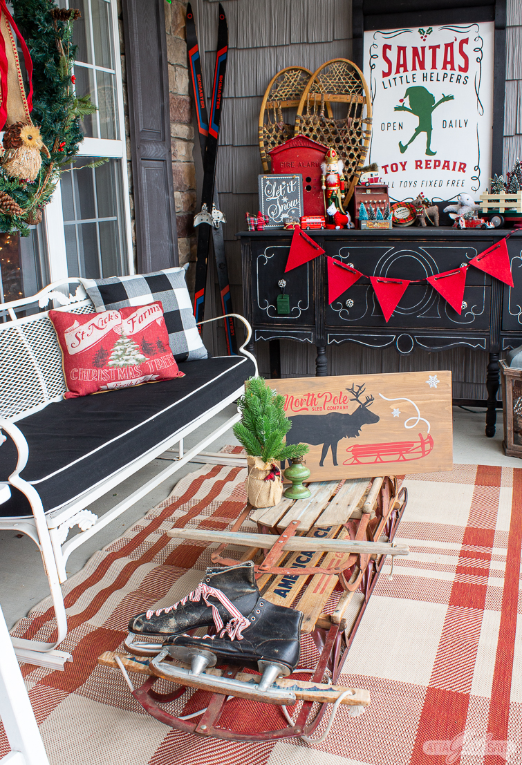Fun and colorful Christmas porch filled with tons of creative ideas like the vintage sled coffee table #christmas #christmasporch #vintagechristmas #christmasdecor #colorfulchristmas #kidschristmasdecor