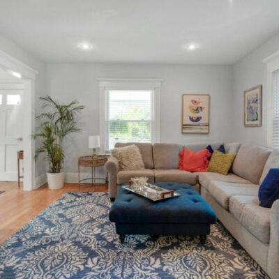 Slow decorating home makeover - love this cozy family room with sectional sofa and blue and white rug kellyelko.com #livingroom #livingroommakeover #livingroomdecor #roommakeover #beforeandafter #cozyhome #kellyelko