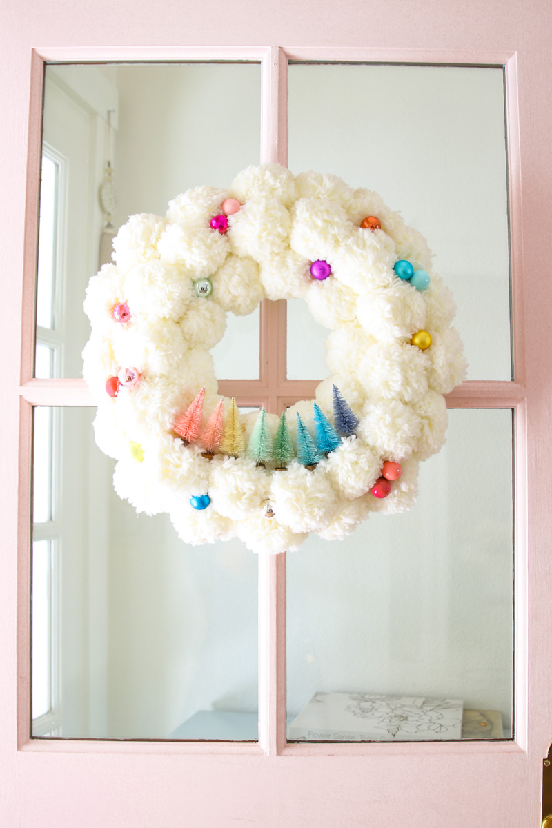 How to make a pom pom wreath with bottle brush trees #christmasdecor #christmascrafts #christmaswreath #diychristmas #colorfulchristmas #christmasdecorations