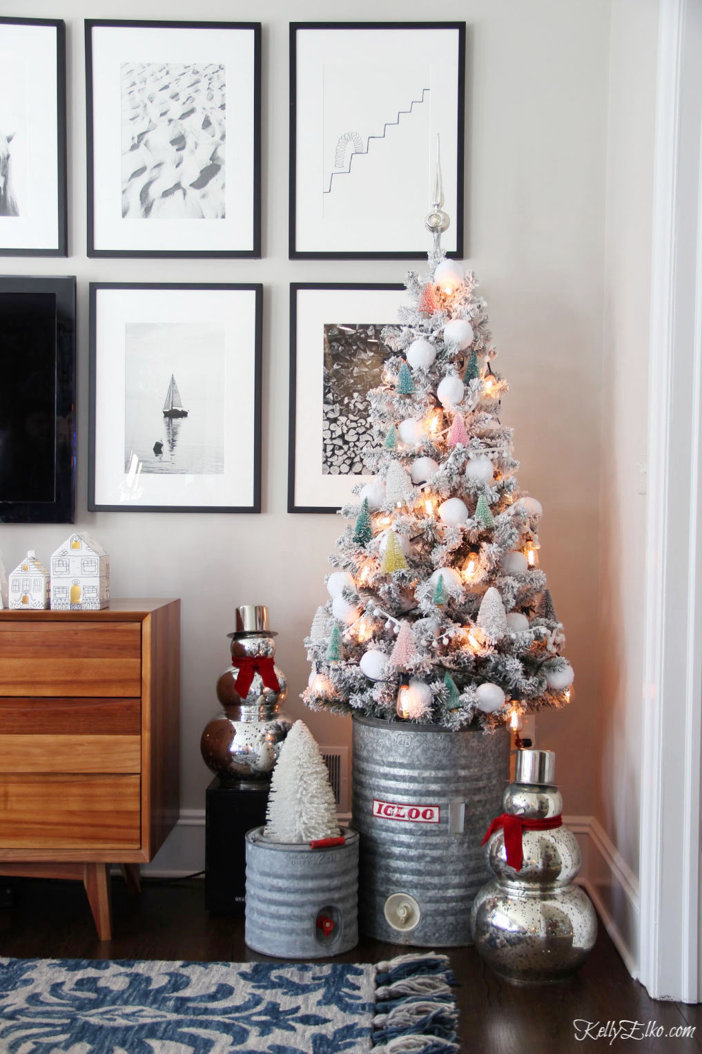 Creative Christmas Home Tour with tons of DIY and decorating ideas like this flocked tree with bottle brush tree ornaments kellyelko.com #christmas #christmasdecor #christmasdecorating #christmashome #christmastour #diychristmas #christmasideas #christmasmantel #christmastree #christmasornaments #vintagechristmas #farmhousechristmas #colorfulchristmas #creativechristmas #kellyelko #bottlebrushtrees #vintagedecor #repurpose #upcycle #mercuryglass