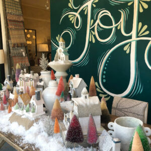 Kelly's Stamp of Approval 7 - love this Putz house and bottle brush tree display with giant Joy sign kellyelko.com #christmasdecor #christmas #putzhouses #bottlebrushtrees #joy #vintagechristmas #kellyelko #christmascenterpiece #christmastable