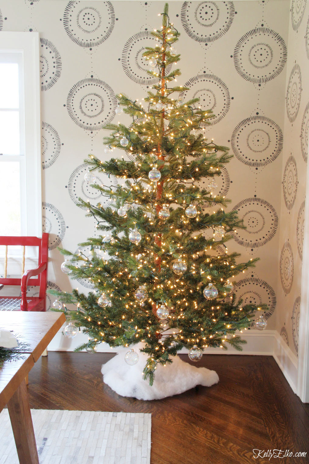 This Christmas Home Tour has the most beautiful trees covered in tons of lights and clear ornaments kellyelko.com #christmas #christmasdecor #christmasdecorating #christmashome #christmastour #diychristmas #christmasideas #christmasmantel #christmastree #christmasornaments #vintagechristmas #farmhousechristmas #colorfulchristmas #creativechristmas #kellyelko #glassornaments #diychristmas #christmastreeskirt