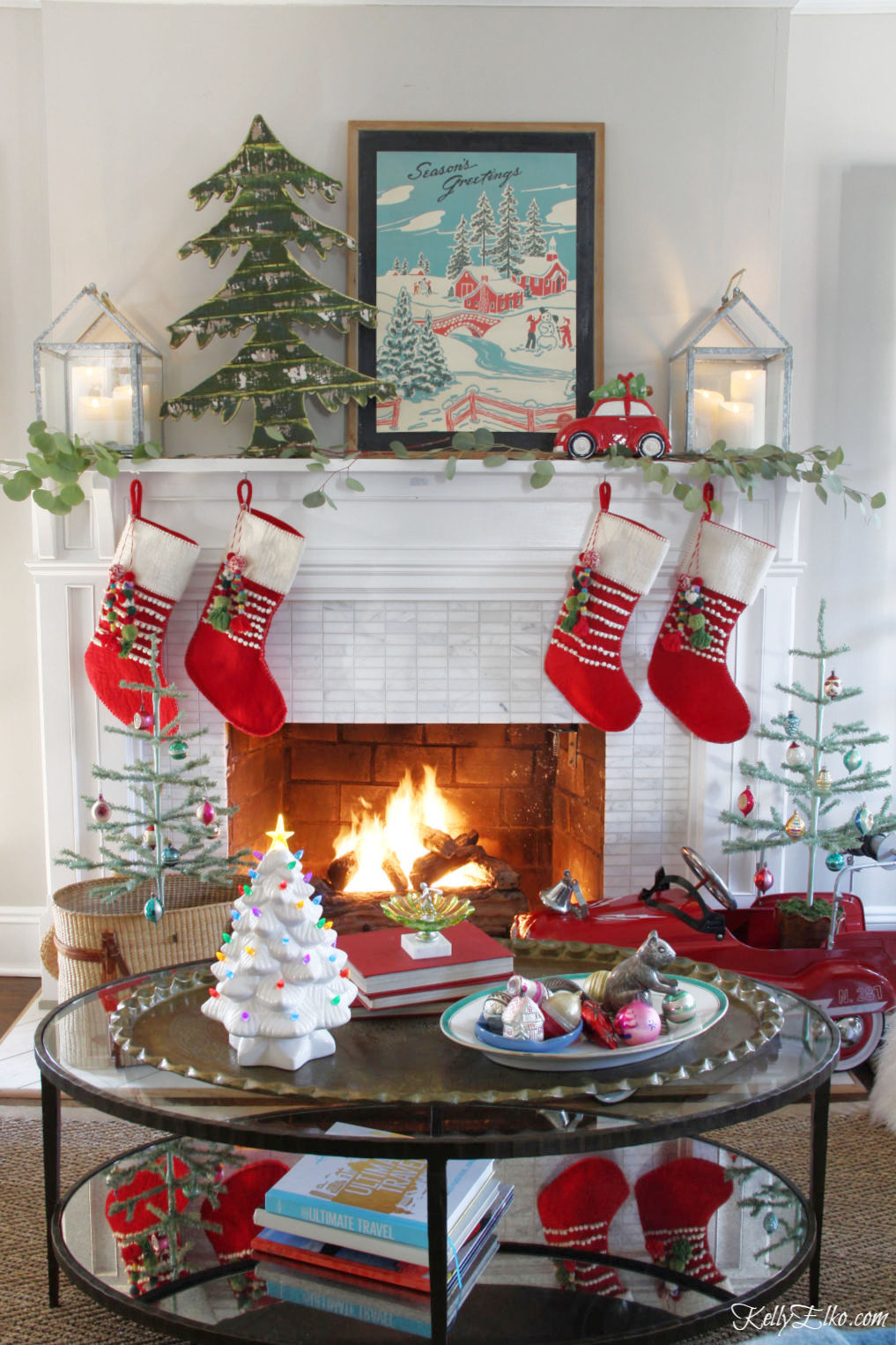 Creative Christmas Home Tour - love this colorful mantel with a mix of vintage and new kellyelko.com #christmas #christmasdecor #christmasdecorating #christmashome #christmastour #diychristmas #christmasideas #christmasmantel #christmastree #christmasornaments #vintagechristmas #farmhousechristmas #colorfulchristmas #creativechristmas #kellyelko