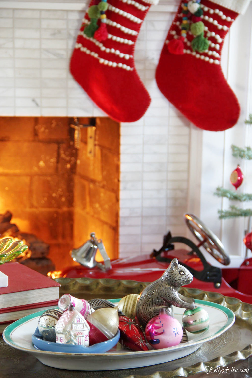Christmas display of old ornaments on a vintage platter kellyelko.com #christmas #christmasdecor #christmasdecorating #christmashome #christmastour #diychristmas #christmasideas #christmasmantel #christmastree #christmasornaments #vintagechristmas #farmhousechristmas #colorfulchristmas #creativechristmas #kellyelko #shinybrites
