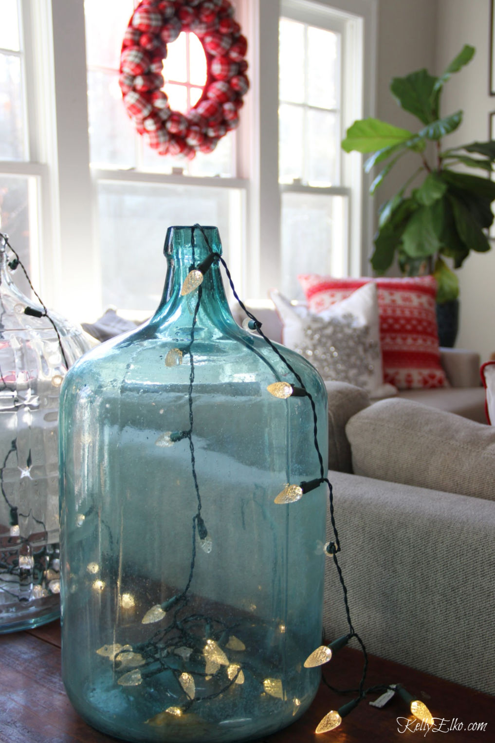 Christmas Home Tour - love this old glass jar filled with string lights kellyelko.com #christmas #christmasdecor #christmasdecorating #christmashome #christmastour #diychristmas #christmasideas #christmasmantel #christmastree #christmasornaments #vintagechristmas #farmhousechristmas #colorfulchristmas #creativechristmas #kellyelko #christmaslights #diychristmas