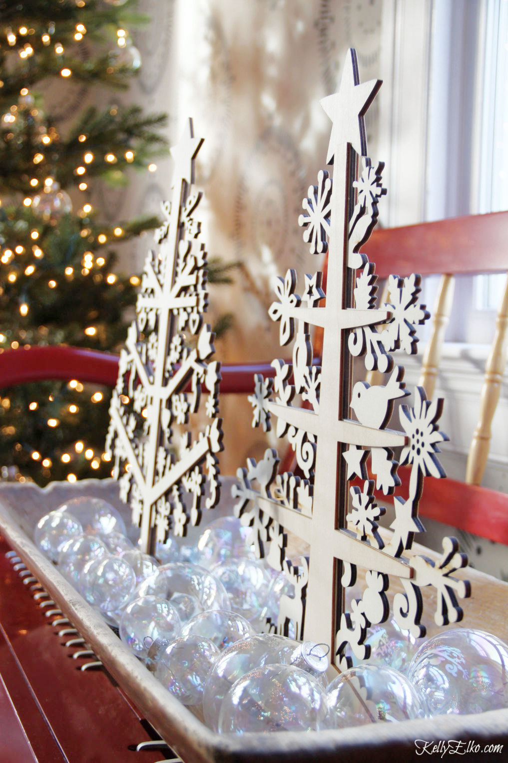 Creative Christmas Home Tour - love this dough bowl filled with clear ornaments and wood cut trees kellyelko.com #christmas #christmasdecor #christmasdecorating #christmashome #christmastour #diychristmas #christmasideas #christmasmantel #christmastree #christmasornaments #vintagechristmas #farmhousechristmas #colorfulchristmas #creativechristmas #kellyelko #doughbowl