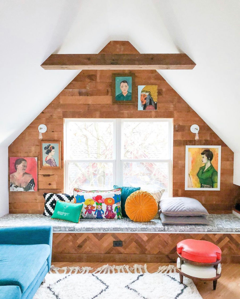 Eclectic Home Tour of Home Ec Interior Design - Love the natural wood shiplap in this attic playroom and the vintage portrait gallery wall #gallerywall #vintagedecor #shiplap #attic #atticdecor #playroom #colorlovers #colorfulinteriors #vintagemodern #bohodecor #eclecticdecor