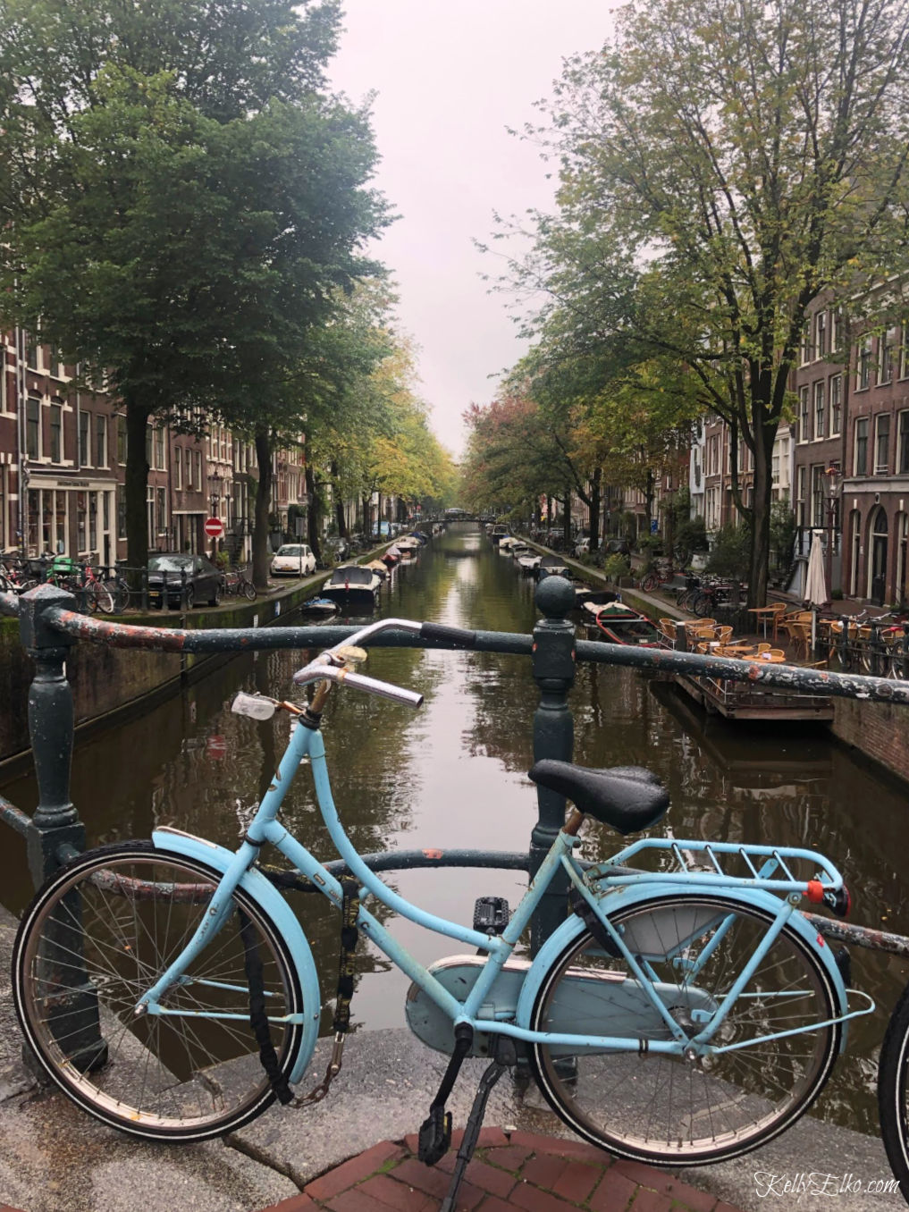 Amsterdam has 165 canals and more bikes than people! kellyelko.com #amsterdam #netherlands #canals #amsterdambike #amsterdamcanal #travel #travelblog #travelblogger #kellyelko