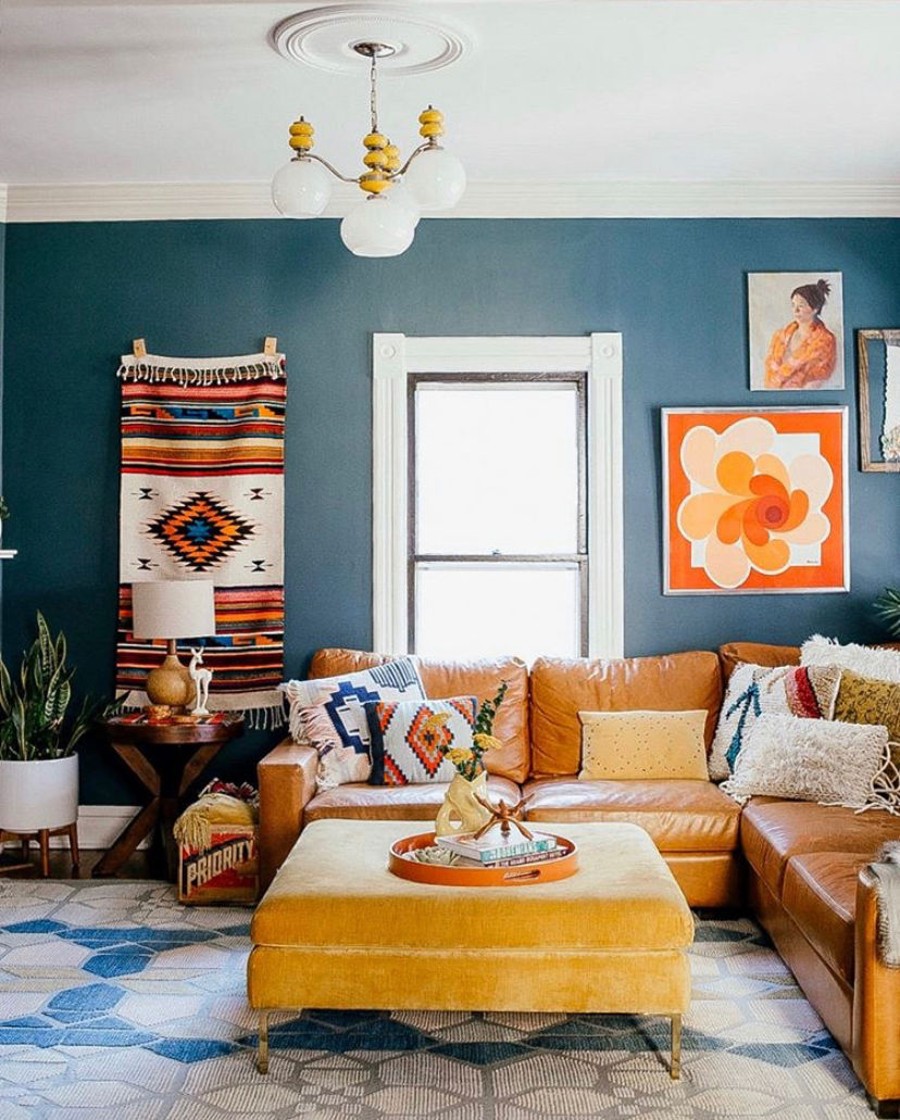 Vintage modern family room with blue walls and leather sectional #sectional #leathersofa #bohodecor #vintagedecor #vintagemodern #bluepaint #bluewalls #eclecticdecor