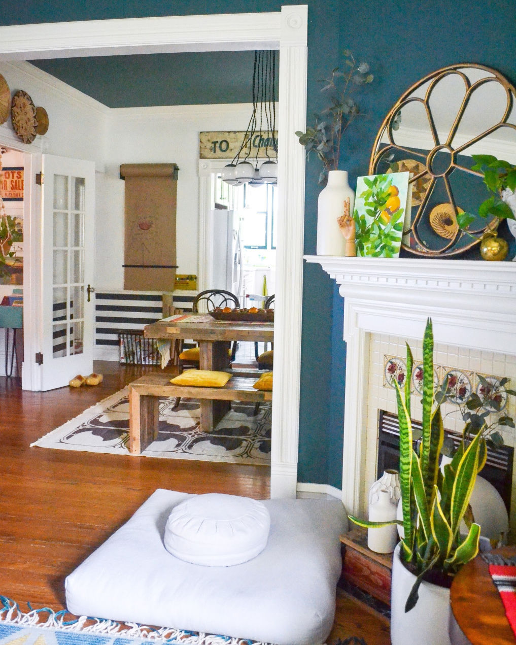 Love this old home with blue walls and eclectic decor #bluepaint #manteldecor #mantel #eclecticdecor #vintagedecor #bohodecor #hometour #diningroomdecor