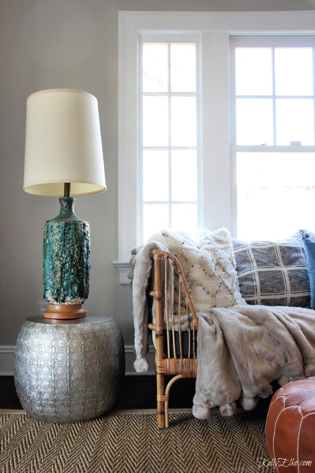 Love this mid century lava glaze lamp and rattan daybed kellyelko.com #vintagedecor #eclecticdecor #midcenturylamp #lighting #vintagelighting #brutalist #bohodecor #cozydecor #farmhousedecor #fixerupperstyle #kellyelko #furnitureplacement
