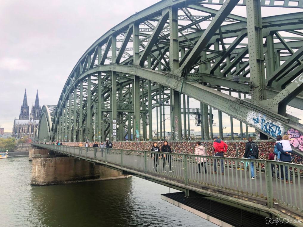 Love Locks Bridge overlooks the Cologne Cathedral in Cologne Germany kellyelko.com #lovelocksbridge #colognegermany #colognecathederal #rhineriver #rivercruise #travel #travelblogger