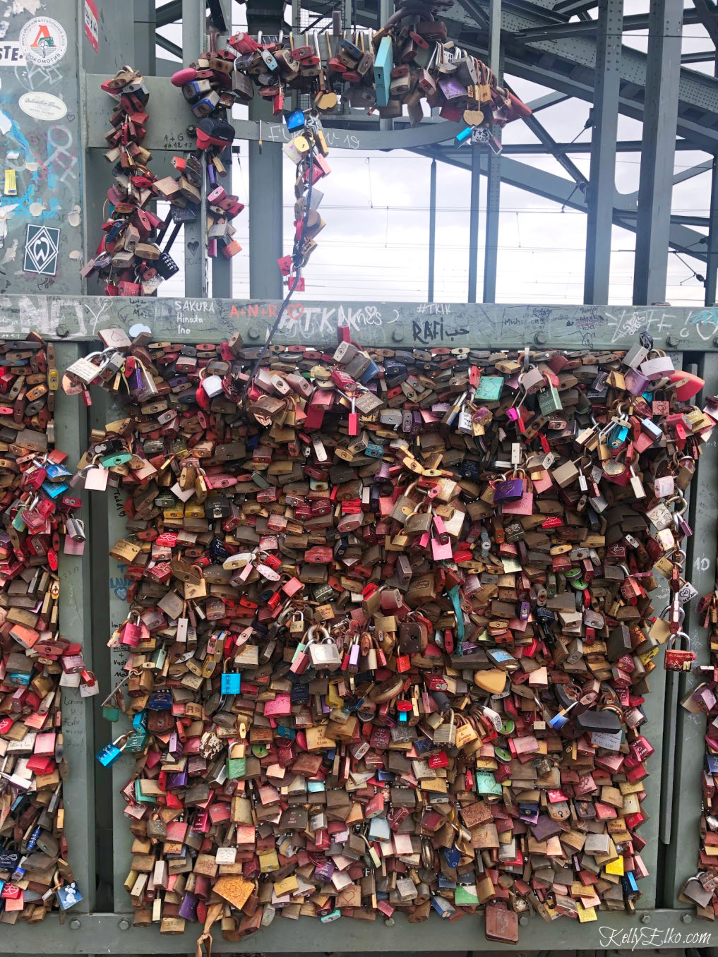 Love Locks bridge in Cologne Germany kellyelko.com #lovelocksbridge #colognegermany #travel #rivercruise #rhineriver